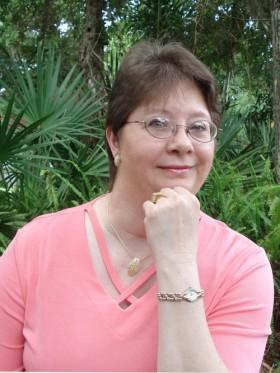 Dellani Oakes with glasses